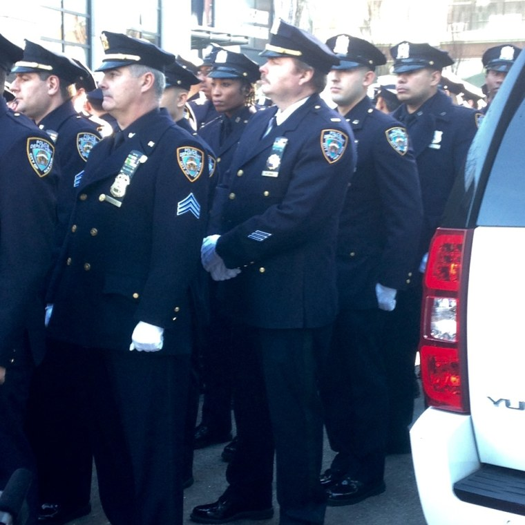 Police officers at a ceremony Dec. 20, 2015, unveiling plaques honoring Wenjian Liu and Rafael Ramos, two NYPD officers slain in the line of duty in 2014.