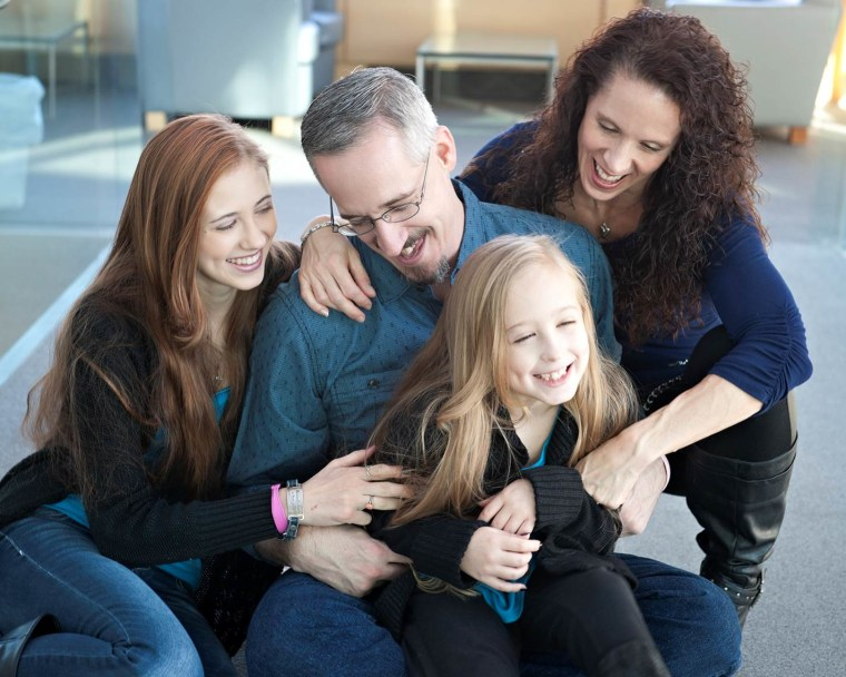 Chrissy Turner, who was diagnosed with a rare form of breast cancer, with her family