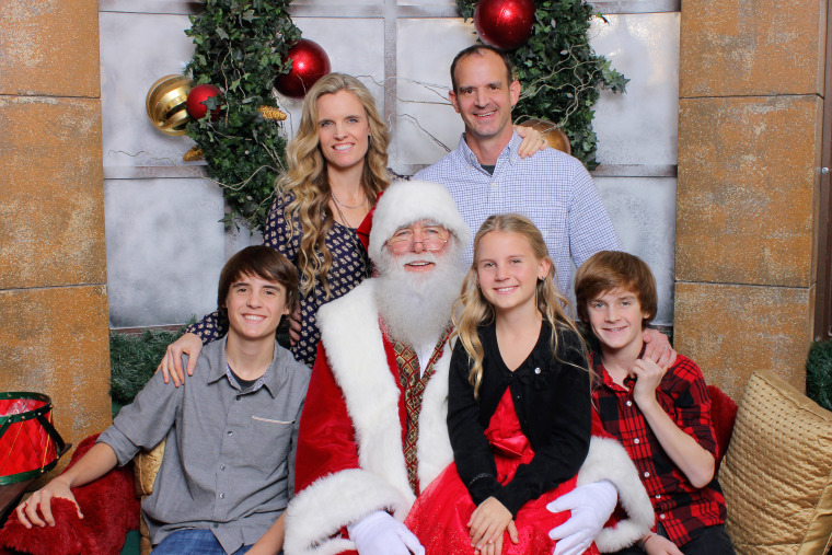 Rob Stella's entire family, including his wife, Rachel, their sons Dylan, 16, and Justin, 14, and their daughter Maddie, 10, take a very special photo with Santa.