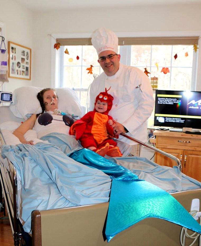 Amanda Bernier and her husband, Chris, with their daughter, Arabella