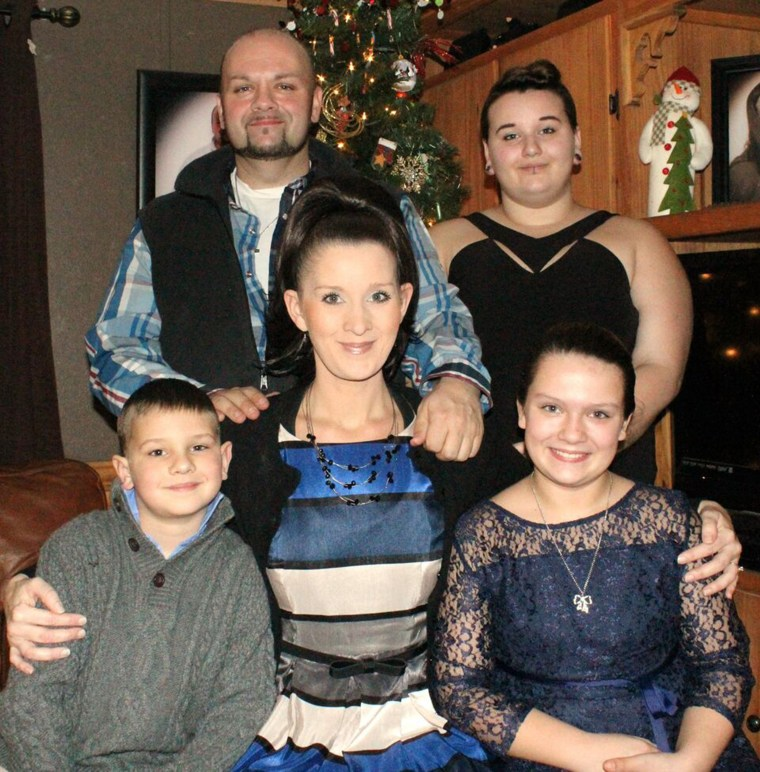Mark Gentle and his family, including Carter, who received an outpouring of support after a post about surgical scars