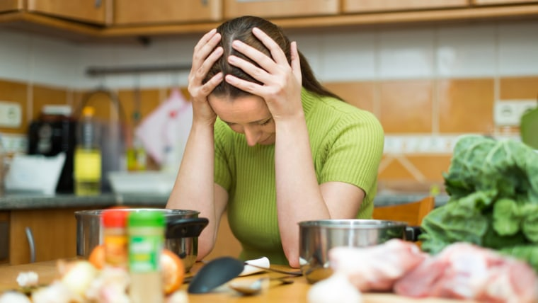 Exhausted female needs to make dinner after working day ; Shutterstock ID 241001536; PO: TODAY.com