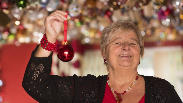 Thousands of Christmas baubles in home