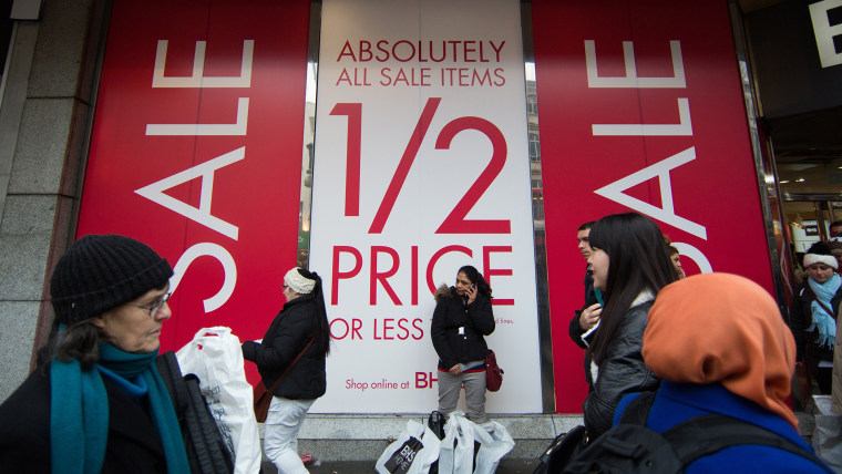 Shoppers walk along Oxford Street to find bargains in central London, on December 26, 2014