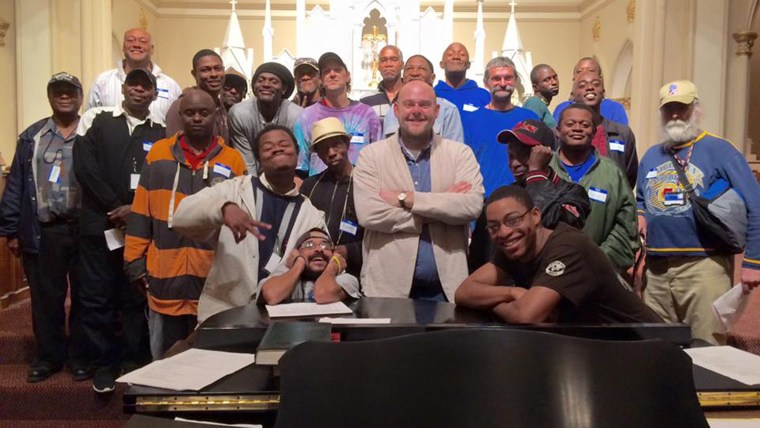 Donal Noonan and the members of the Atlanta Homeward Choir. The group is singing at a White House holiday event on Monday.