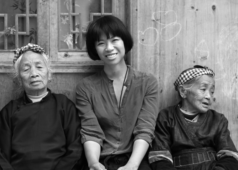 Angel Chang with her teachers. Chang is working with local villagers to combine their traditional fabrics with modern designs.