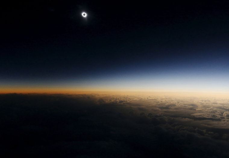"Image: A view from a plane during the so-called ""Eclipse Flight"" from the Russian city of Murmansk to observe the solar eclipse above the neutral waters of the Norwegian Sea"