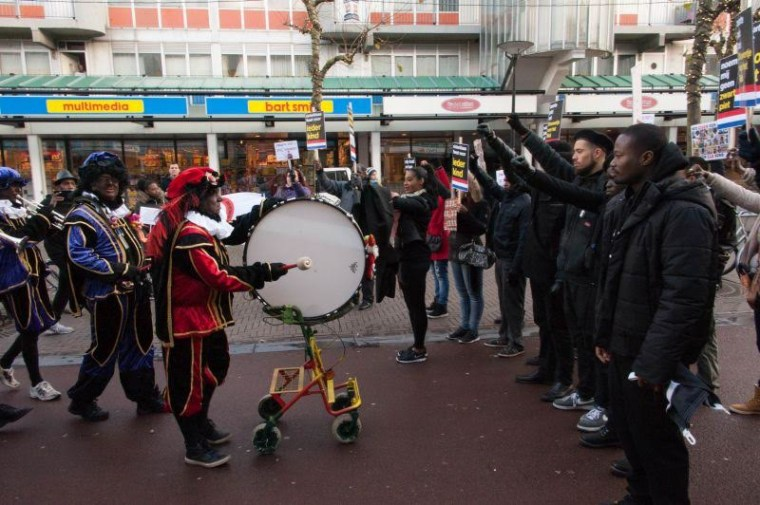Protestors including Zwarte Piet Is Racisme project co-founder, Jerry Afriyie briefly brought the November Sinterklaas arrival parade to a halt by blocking the path of men dressed as Black Pete.