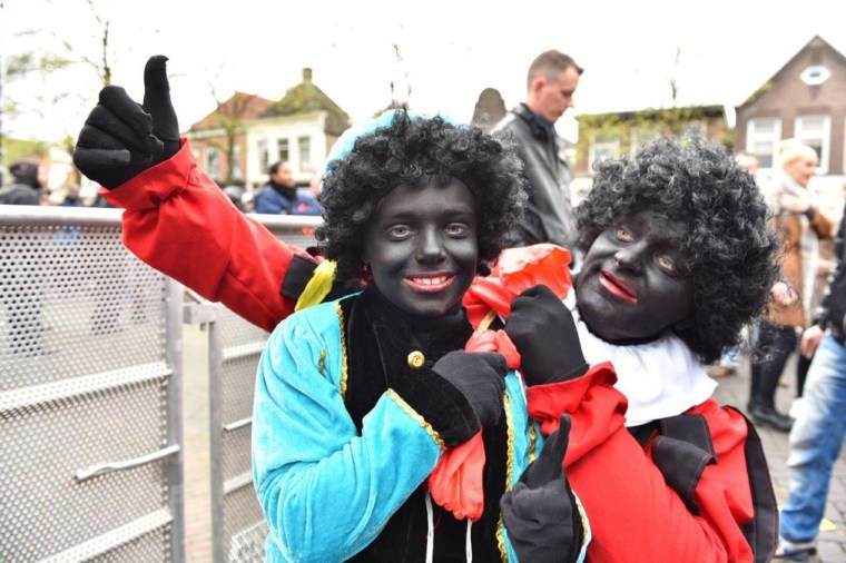 Family members young and old dressed as the controversial character Black Pete during a recent Sinterklaas parade.