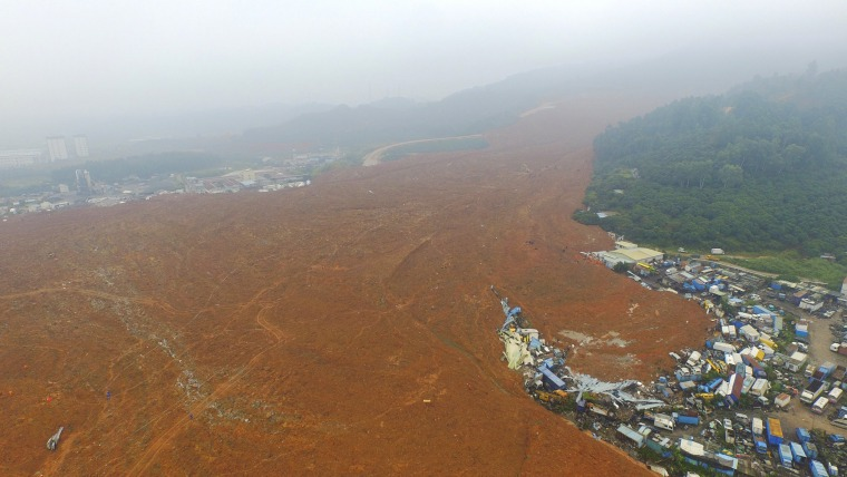 Image: An aerial view shows the site of a landslide which hit an industrial park in Shenzhen