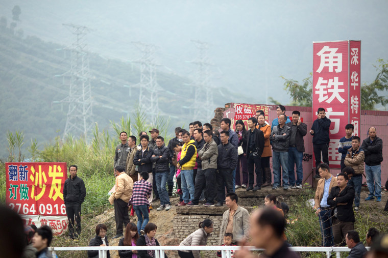 Image: China ramps up search for survivors a day after deadly landslide