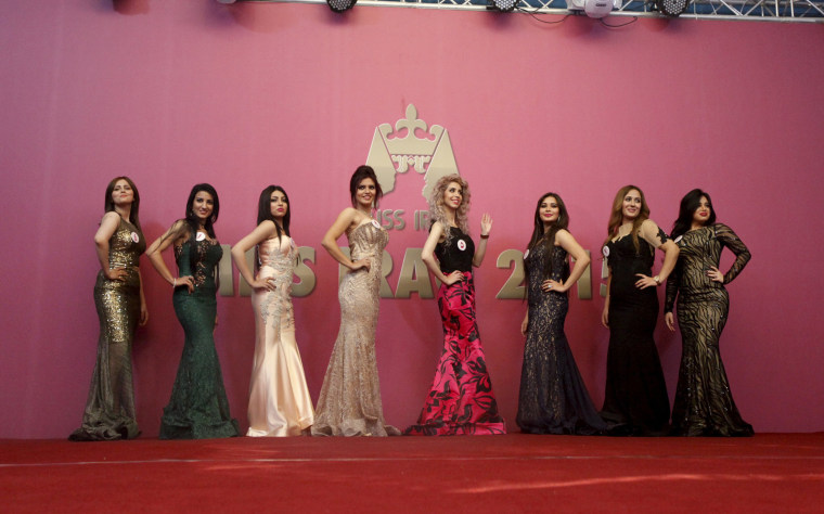 Image: Participants wait for judges to determine the winner of Miss Iraq during the final round of judging in Baghdad