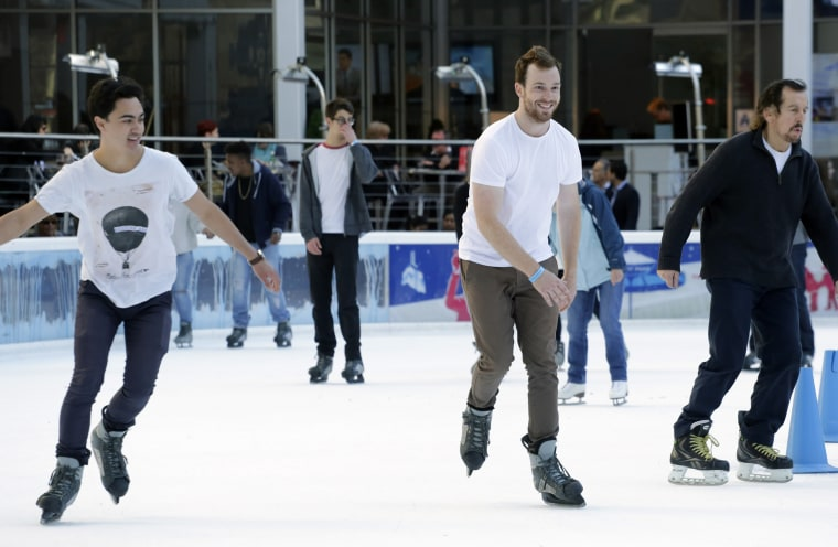 Men in short sleeves skate around the ice rink in Bryant Park on Dec. 15, 2015, in New York as the region experienced unseasonably warm weather.