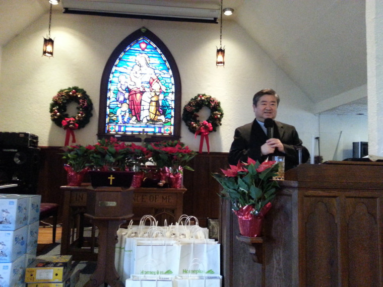 Rev. Sunggook Ahn at Neung Lyuk Church's Christmas church service, December 22, 2013.