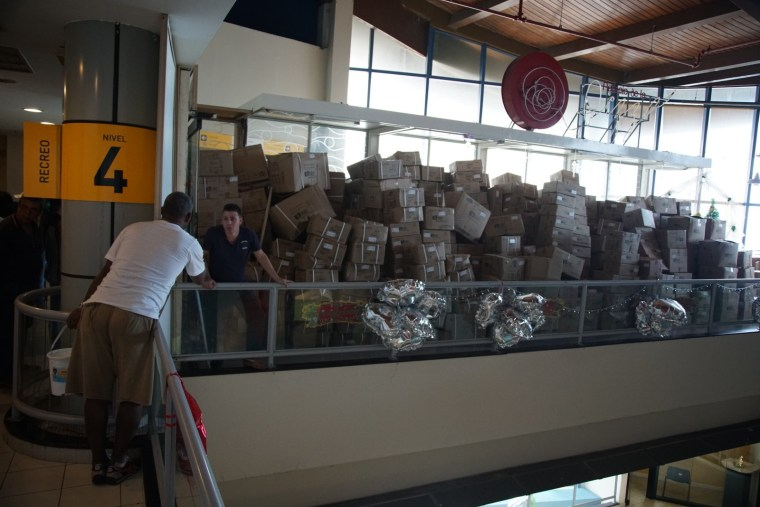 """Cardboard boxes with goods from China at the """"Todo Por Uno"""" store in Havana, Cuba, where all items were one convertible Cuban peso. (Dec. 2015.)"""