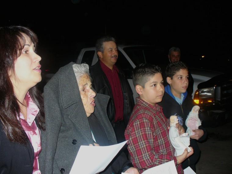 """Griselda Nevarez's grandmother, Mamá Nicolasa, leads a night of """"posadas"""" in Arizona."""