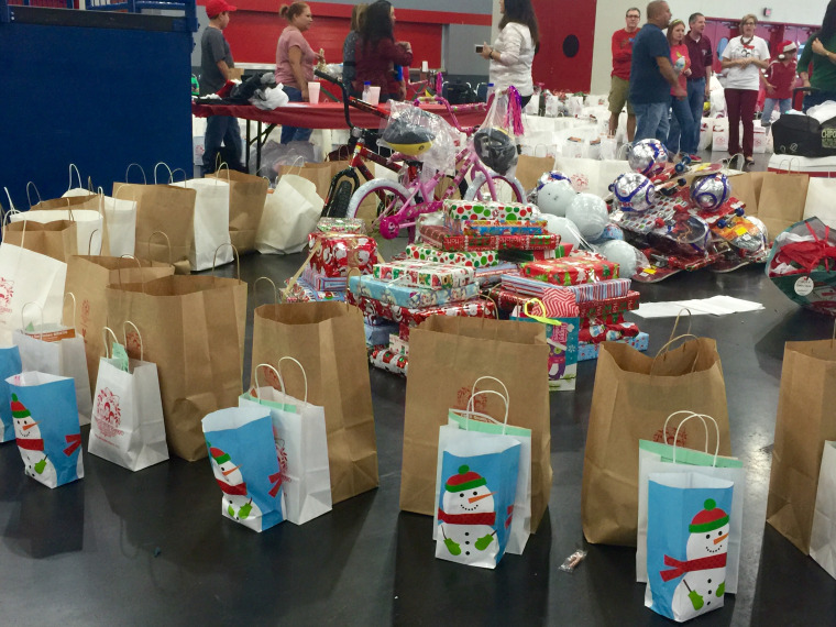 "Gifts lined up for children at the ""Navidad en el Barrio"" event in Houston, TX.  It was started in 1985 by Israel Gomez when he was a police officer in the community."