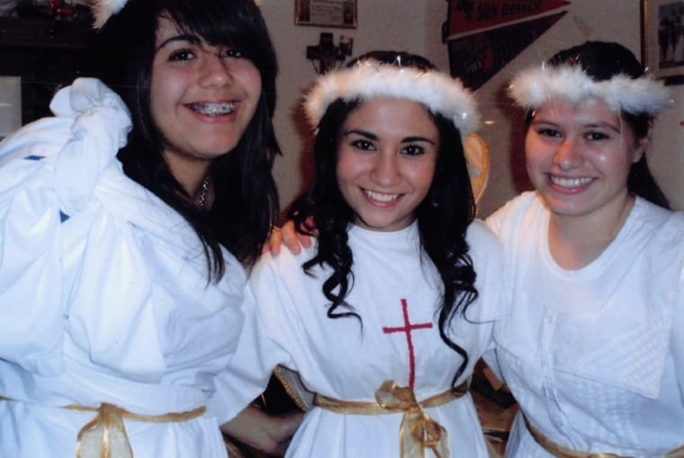 Griselda Nevarez (center) surrounded by a cousin and a friend after they performed a pastorela several years ago.