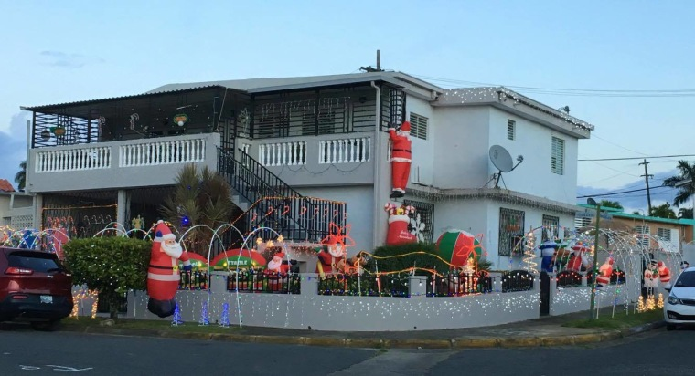 a house decorated for christmas in san juan pr