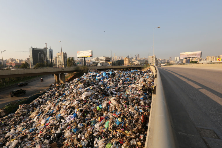Image: A general view shows a garbage-filled area in Beirut