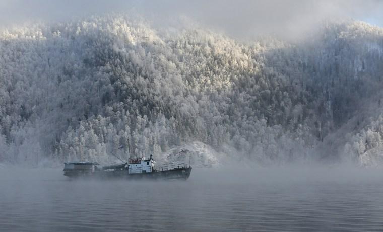 Image: Motor boat sails along Yenisei River outside Krasnoyarsk