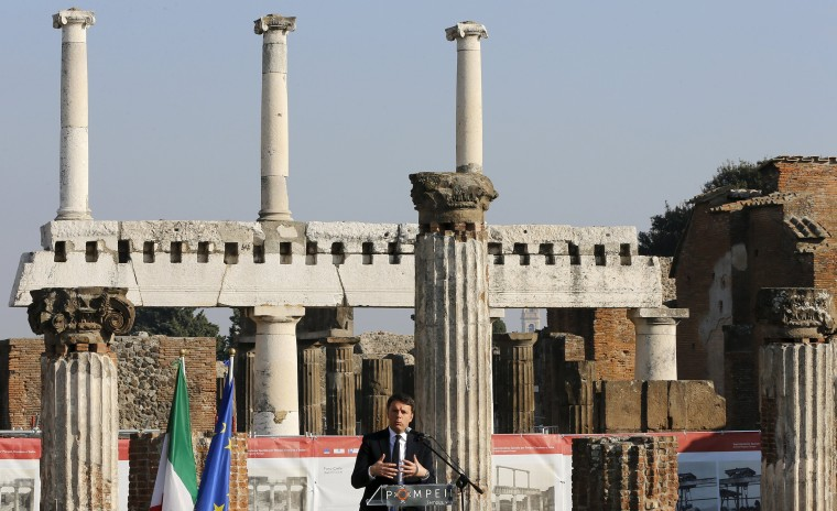 Image: Italian Prime Minister Matteo Renzi speaks during the unveiling ceremony for the opening of six restored domus at the archaeological site of Pompeii, Italy