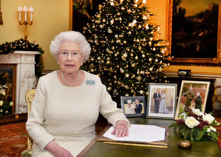 Image: Britain's Queen Elizabeth sits at a desk in the 18th Century Room at Buckingham Palace, London, after recording her Christmas Day broadcast to the Commonwealth, in London