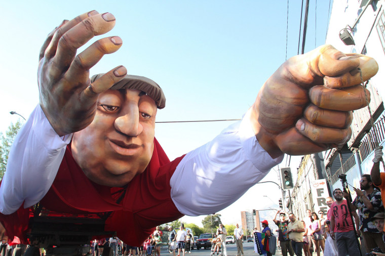 Image: Street carnival 'Neruda coming flying'