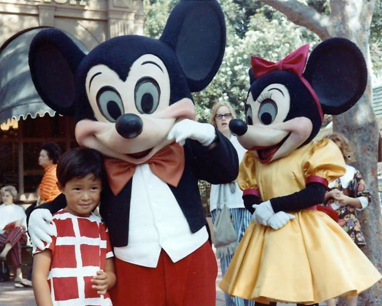 Frances Kai-Hwa Wang with American icons Mickey and Minnie Mouse at Disneyland in California.