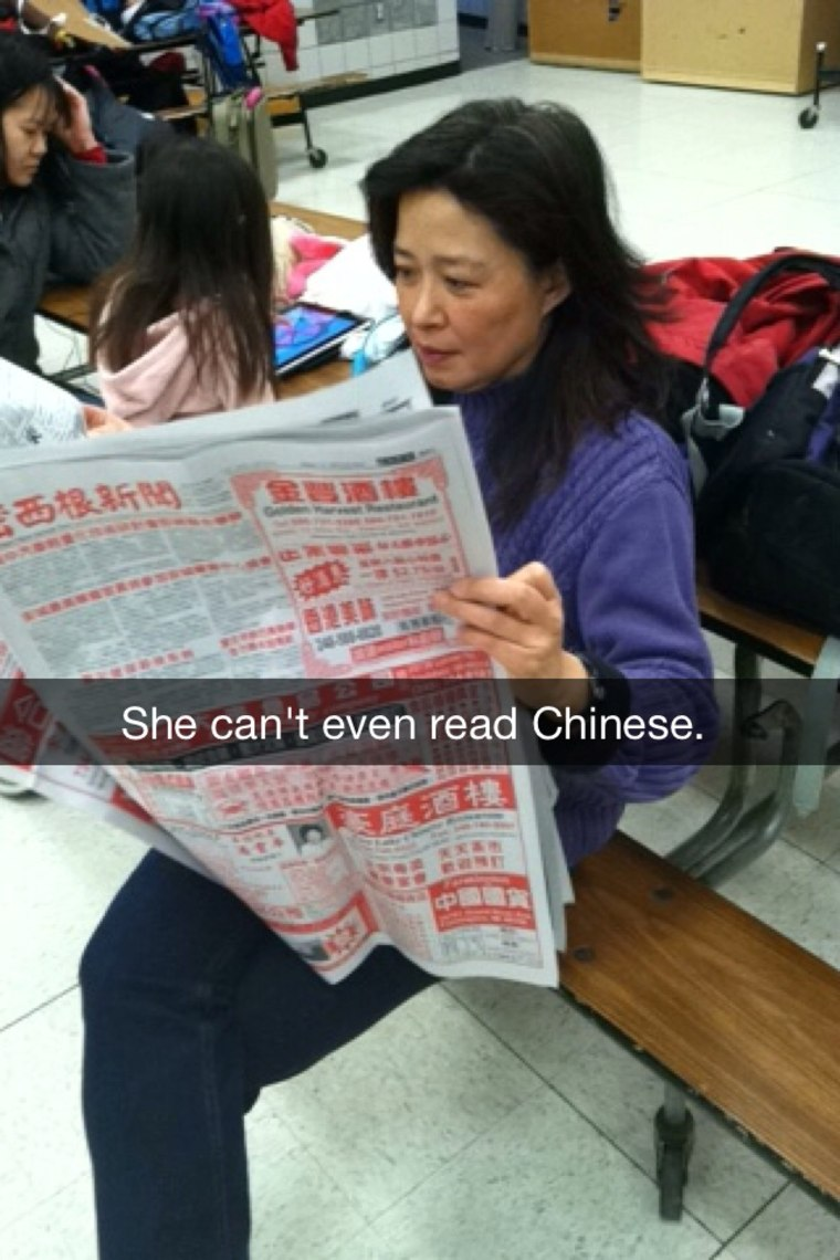 Frances Kai-Hwa Wang, outed by her children on Snapchat while glancing through the Chinese newspaper during Chinese school in Michigan.