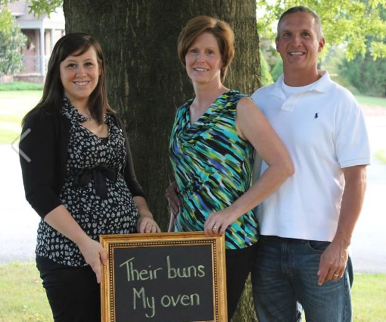 Sandi and Philip (right) announce they are expecting twins, with the help of their friend Andrea Rivas.