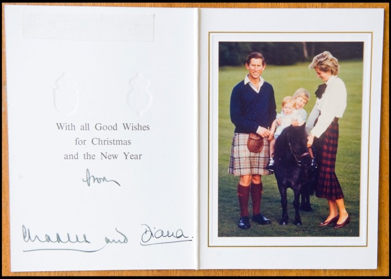 BNPS.co.uk (01202 558833) Pic: Phil Yeomans/BNPS  Happy couple with William and Harry- Xmas 1985.  A poignant collection of Royal Xmas cards sent to a member of staff and signed by Charles and Diana is coming up for auction.   The cards show the Xmas portraits from the earliest days of the marriage in 1982 and catologue the birth of William and Harry in the following years.   The happy smiling cards give no hint to the bitterness and tragedy that would engulf the couple in later years.