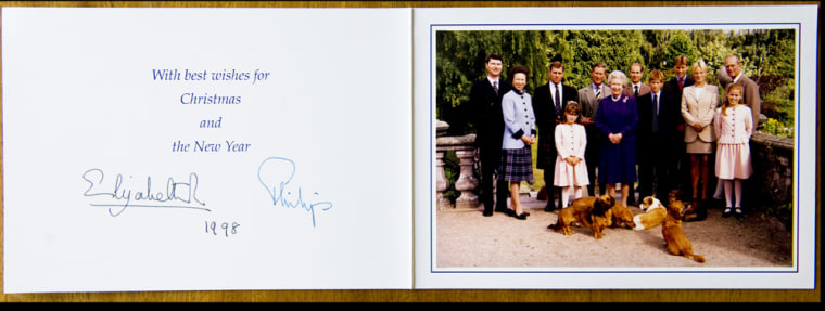 BNPS.co.uk (01202 558833) Pic: Phil Yeomans/BNPS  A show of unity, without Diana and Sarah Ferguson, in  Xmas card sent by the Queen in 1998.  A Royal Xmas cards sent to a member of staff and hand signed by the Queen and Prince Philip is being auctioned by Dukes of Dorchester.