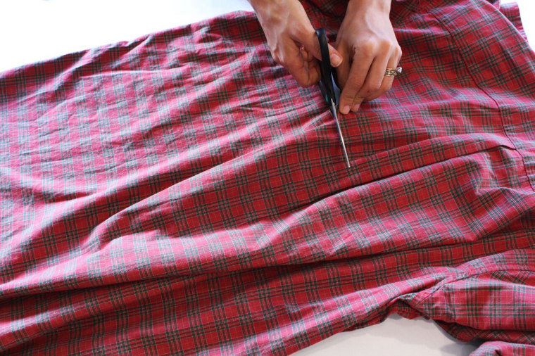 Lay the button-down shirt flat and cut across horizontally, starting right under sleeves. Discard the top section.