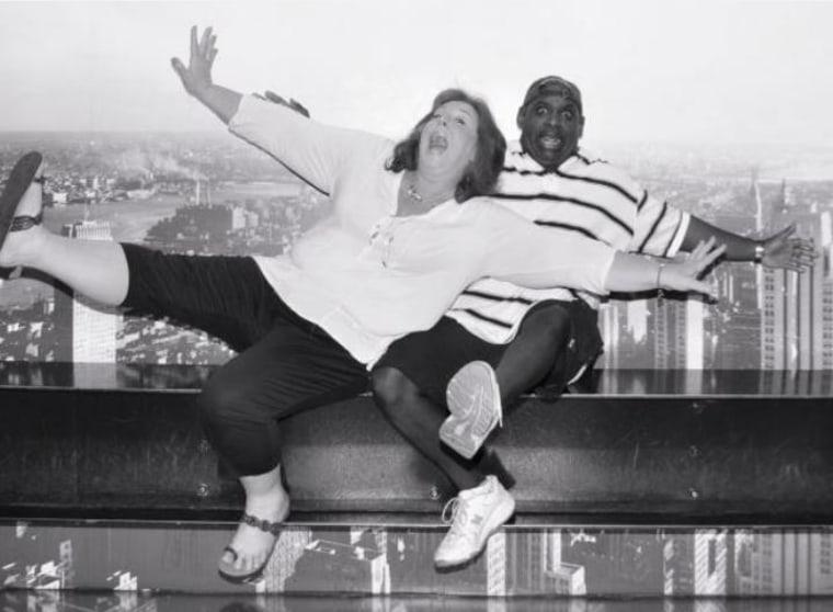 Jenn Mendez and Lane Stowe clown for the camera in Rockefeller Center.