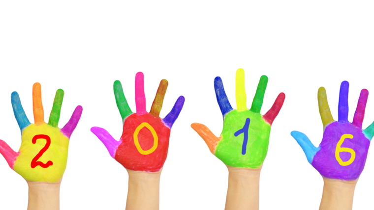 Kids colorful hands forming number 2016.