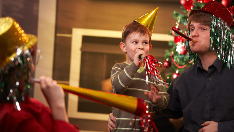 Parent and child celebrating New Year's Eve together
