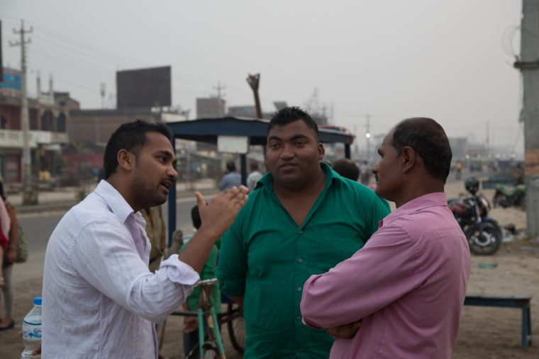 Ravi Kumar speaks with local residents in Janakpur, Nepal. Kumar was born and raised just outside of Janakpur, but left to study in the United States in 2007.