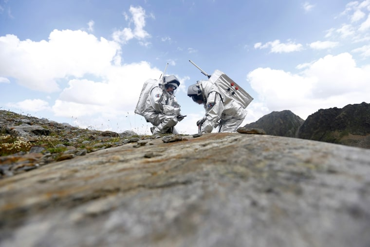 Image: Elorza of Spain and Dobrovolny of Austria take stone samples during a simulated Mars mission on Tyrolean glaciers in Kaunertal