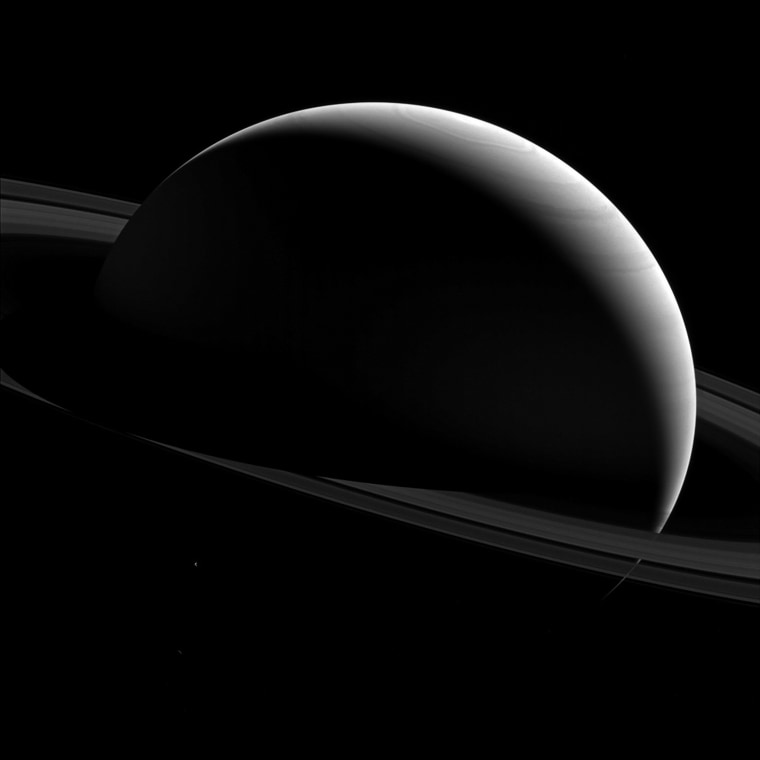 Image: Saturn and moon Tethys seen in a NASA handout image