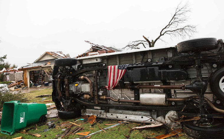 Image: An American flag placed by first responders is seen in the aftermath of a tornado in Rowlett, Texas.