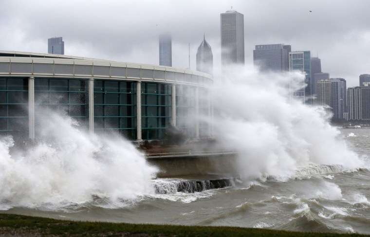 Image: Wind blown waves from Lake Michigan break around the Shedd Aquarium as a winter storm moves across Illinois on Monday in Chicago