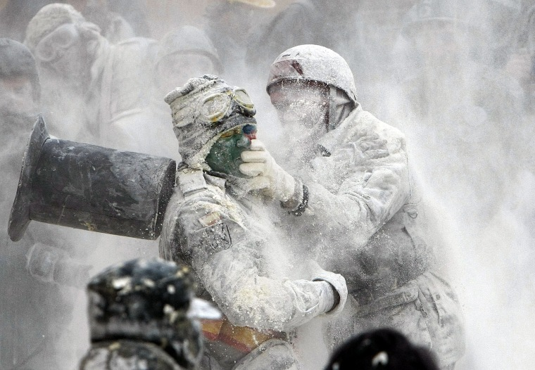 Image: People take part in the flour fight as part of the winter festival in Ibi, Alicante, eastern Spain