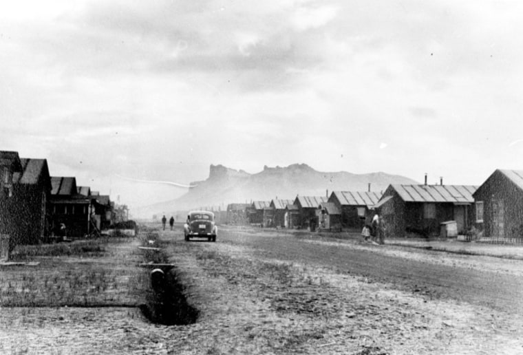 The barracks at Tule Lake Segregation Center with Castle Rock in the background. At its peak, the camp housed more than 18,000 people.