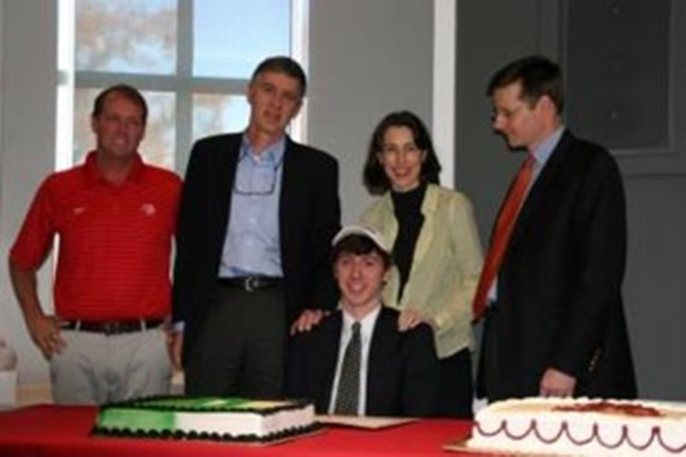 Image: Tate Nathaniel Ramsden signing his letter of intent with Dartmouth in 2012