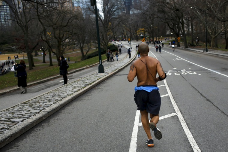 Image: A man jogs during a warm day in Central Park, New York