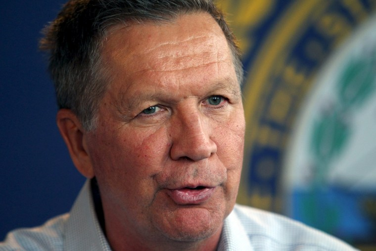 Image: U.S. Republican presidential candidate and Ohio Governor Kasich speaks to the media following a campaign town hall meeting in Nashua, New Hampshire
