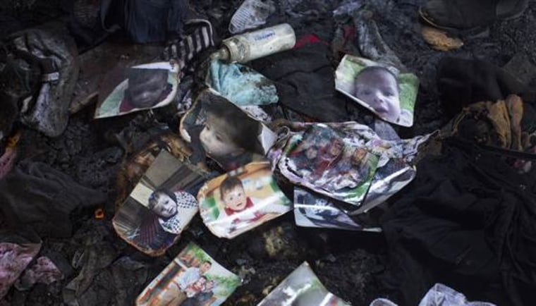 Image: Charred pictures on the ground of the Dawabsheh family home