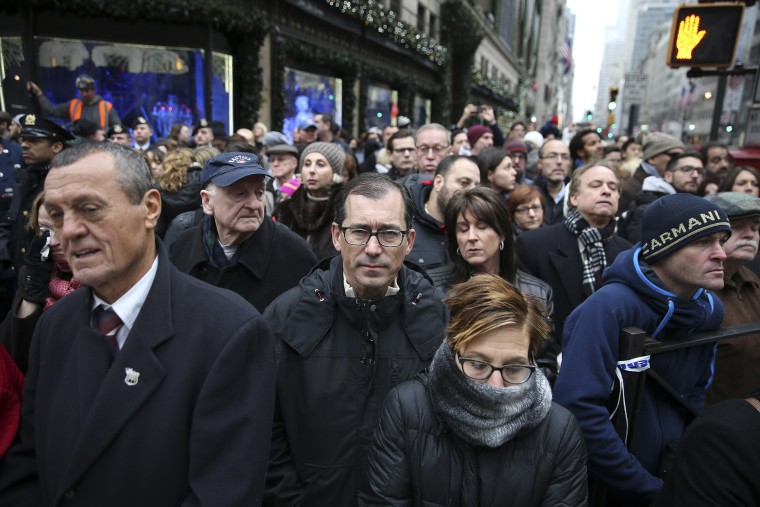 Image: Mourners pay their respects outside St. Patrick's Cathedral for the funeral service of Joseph Lemm in New York.