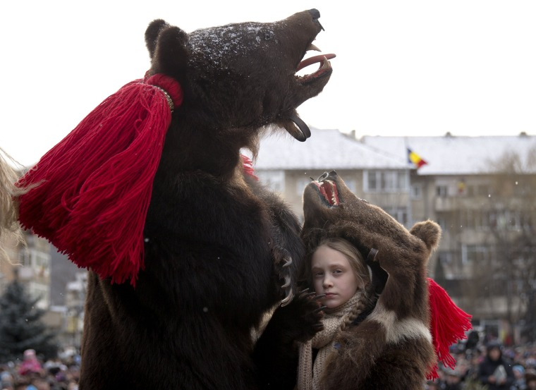 Image: People wearing bear furs perform during a festival of New Year ritual dances